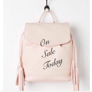 Pink tassel backpack